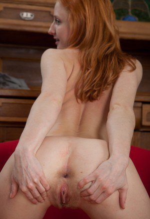 Pale redhead rolls off her pantyhose while displaying her almost flat chest