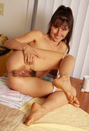 Mature lady slips off lace underwear to showcase her hairy vagina