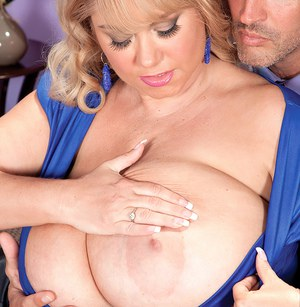Overweight blonde with monster tits spits on her husbands cock