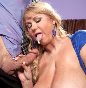 Overweight blonde with monster tits spits on her husband's cock