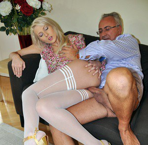 Young blonde gets dressed in sexy stockings before fucking an old man