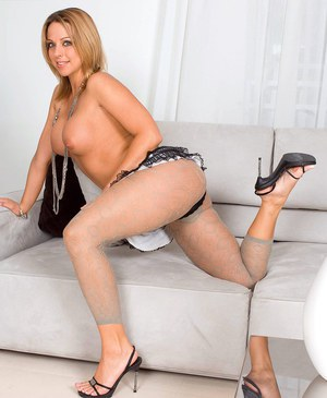 Beautiful blonde MILF with firm big tits licks her sexy bare feet