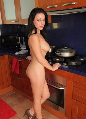 Hot MILF with black hair Angelica Raven holds her big naturals as she strips