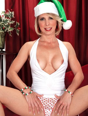 Hot mature woman shows her big tits while getting naked at Xmas