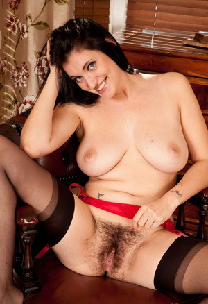 Solo girl removes her black skirt and underwear to display her hairy muff