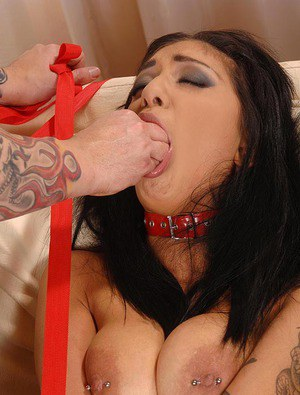Collared BDSM fetish model Mai Bailey mouth fucked and fisted by bare hand