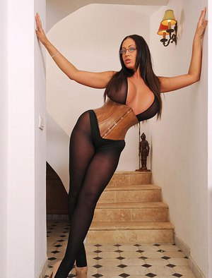 Glasses adorned curvy babe Emma Butt flaunting big knockers in pantyhose