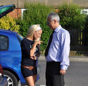 Young blonde in Uggs and knee socks seduces an old man in the parking lot