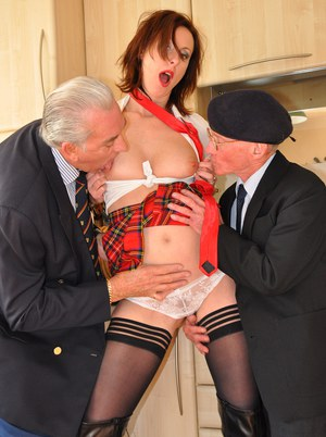 Schoolgirl shows her respect to two veterans by sucking their oldman cocks