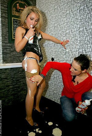 Bisexual girls gets covered in jizz via a gloryhole in the wall
