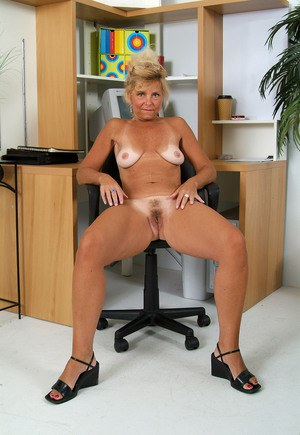 Naughty mature MILF Cricket strips naked  spreads in her office chair