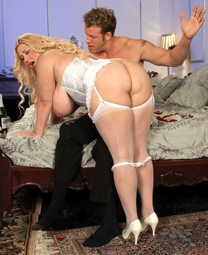 Overweight blonde with huge boobs gets banged in white corset and stockings