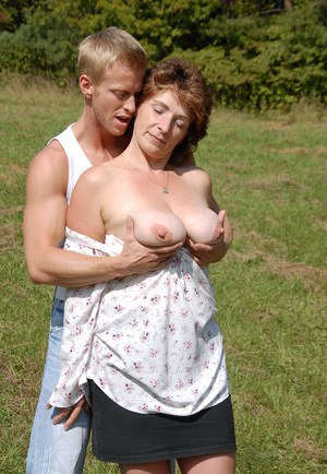 Busty older mom fress her floppy tits for a young man cumshot at the park