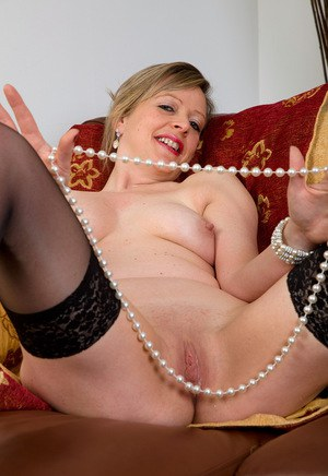 Sassy mature woman Lou teasing with pearls and a bare shaved pussy