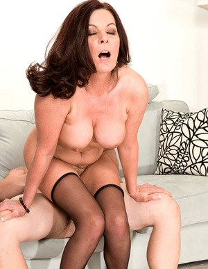Busty older lady Magdalene St Michaels blows her toy boy before intercourse