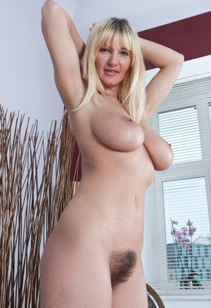 Leggy blonde woman Vanessa J uncovers her big naturals and hairy muff too