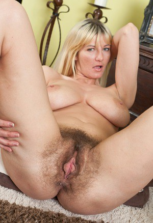 Horny MILF Vanessa J showing a close up view of her extremely hairy beaver