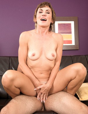 Older lady Lillian Tesh jerks toy boy's big cock before riding on top
