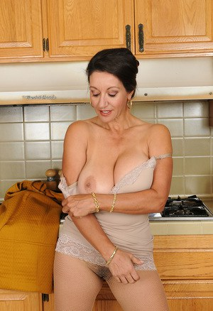 Classy mature Persia frees great big tits & flaunts bare feet in the kitchen