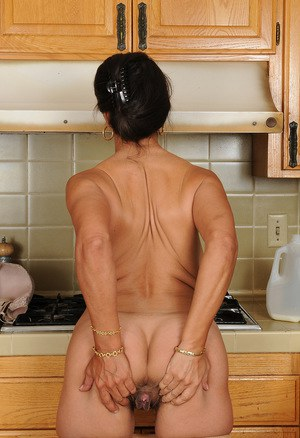 Classy mature Persia frees great big tits  flaunts bare feet in the kitchen
