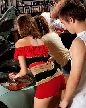Perky titted young teens explore their sexuality in threesome in dad's garage