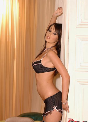 Stocking and lingerie attired Angel Kiss revealing big tits in high heels