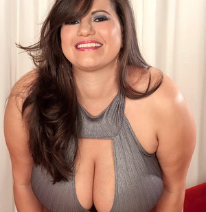 Brunette BBW Melonie Max flashes upskirt panties before unveiling her knockers