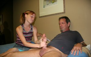 Tiny young girl Alyssa Hart jerks off an older guy to settle her debt