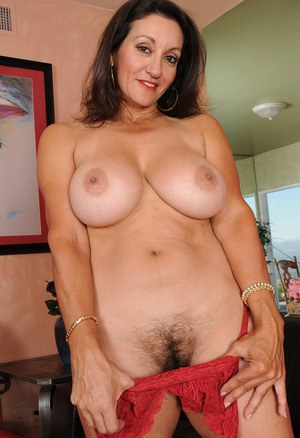 Busty beautiful mature Persia squeezes her round big tits  shows off hot ass