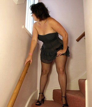 Older UK lady Daniella English flashes her big butt and pussy wearing fishnets