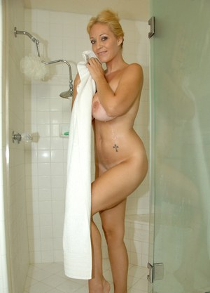 Blonde amateur exposes her large tits before heading into the shower