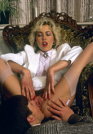 Vintage pornstar toys her lovely ass while riding a big fat stiffy