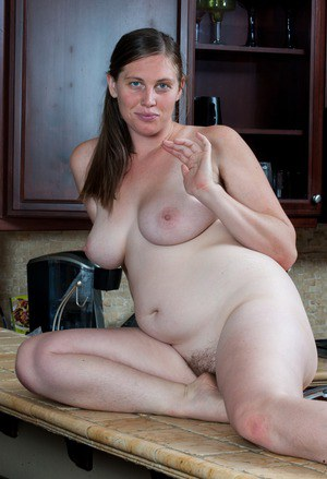 Plump solo girl bares her natural tits and big ass before showing her beaver