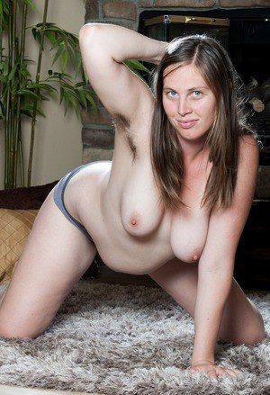White plumper with big natural tits unveils her hairy armpits and bush