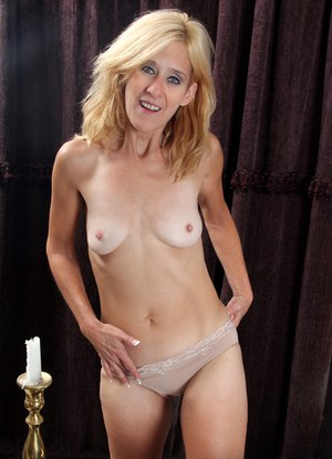 Horny blonde mature woman reveals her small saggy tits for naked masturbation
