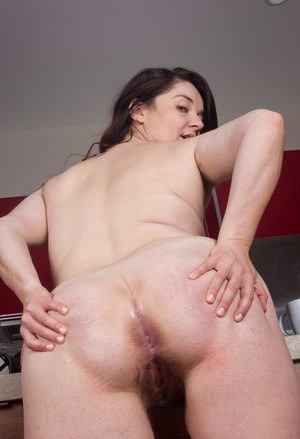 Thick female Maxine Holloway unveils her hairy pits before parting her beaver