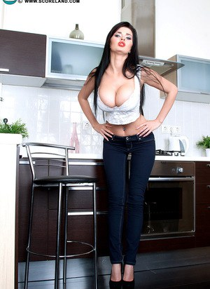 Dark haired solo girl Sha Rizel uncovers her huge tits as she undresses