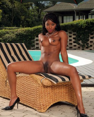 Ebony doll displaying her sexy caramel pussy and hot tits at the pool