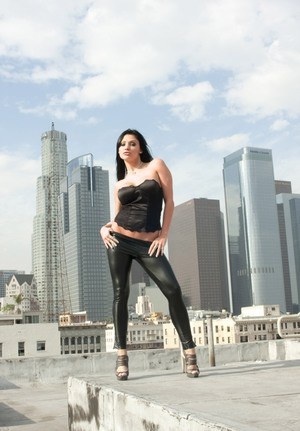 Dark haired chick gets banged after rooftop modeling gig in leather pants