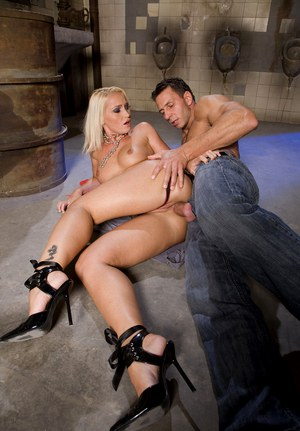Blonde in red dress gets ass fucked in the bowels of a warehouse