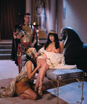 Cleopatra attired female with beautiful tits bangs her lover on bed