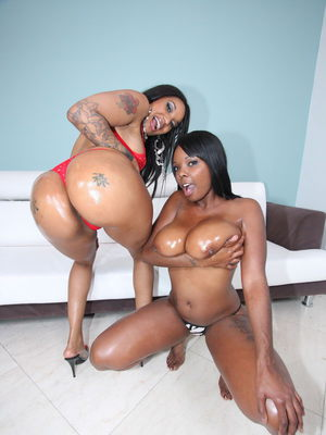 Black girls with big butts get oiled up prior to an ebony threesome
