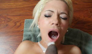 Platinum blonde chick takes a huge cumshot from a BBC on her face