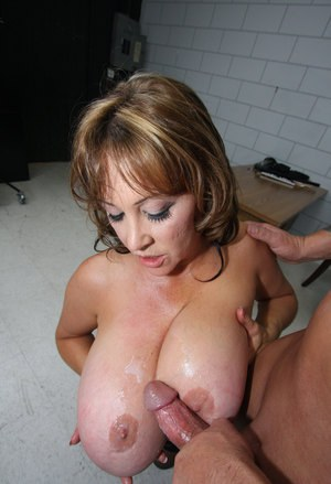 Chesty mature inmate bares giant big tits for lesbian sex with big busty guard