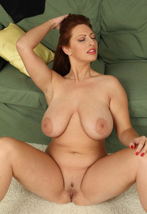 Middle aged woman releases her big natural tits as she removes her lingerie