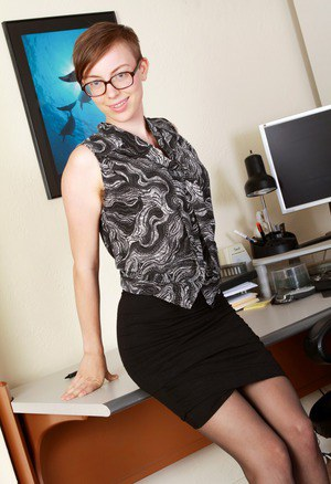 Hirsute dyke with short red hair and tattoos showcases her bush in desk chair