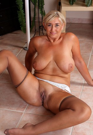 Busty mature wife Melyssa flashes panty upskirt  poses in white garter
