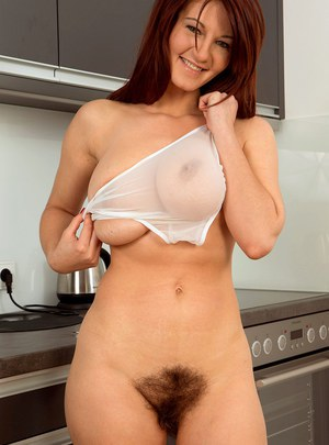 Huge titted MILF Vanessa Y takes her panties off and shows her hairy pussy