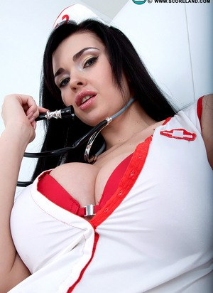 Dark haired nurse Sha Rizel sheds her uniform to pose with her big saggy tits