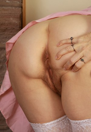 Mature mom Lilli in satin lingerie reveals big tits  rubs clit in stockings